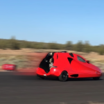 picture of a flying car moving fast on the ground