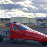 picture of flyng car on tarmac testing with turbo charger re-installed
